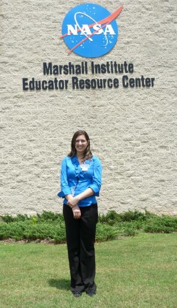 Photo: Samantha Rawlins in front of NASA''s Marshall Space Flight Center.