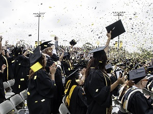 Graduating students celebrate during their ceremony