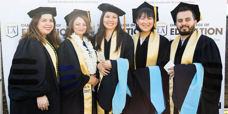 CCOE doctoral students wearing regalia at commencement