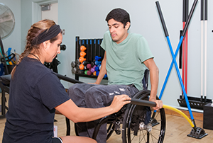 client in wheelchair and student