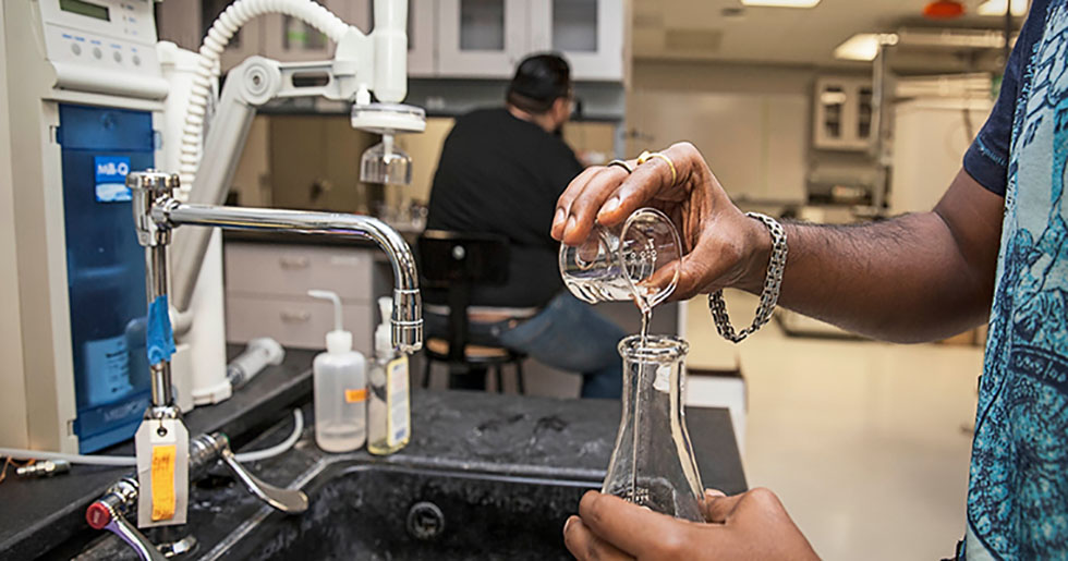 Pouring liquids in a lab