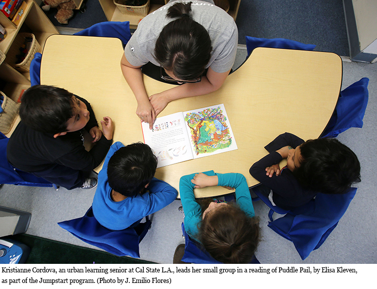 Kristianne Cordova, an urban learning senior at Cal State L.A., leads her small group in story time.