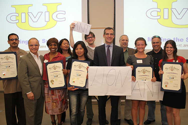 Cal State L.A. President William A. Covino and Los Angeles Mayor Eric Garcetti present certificates to students who completed Civic University.