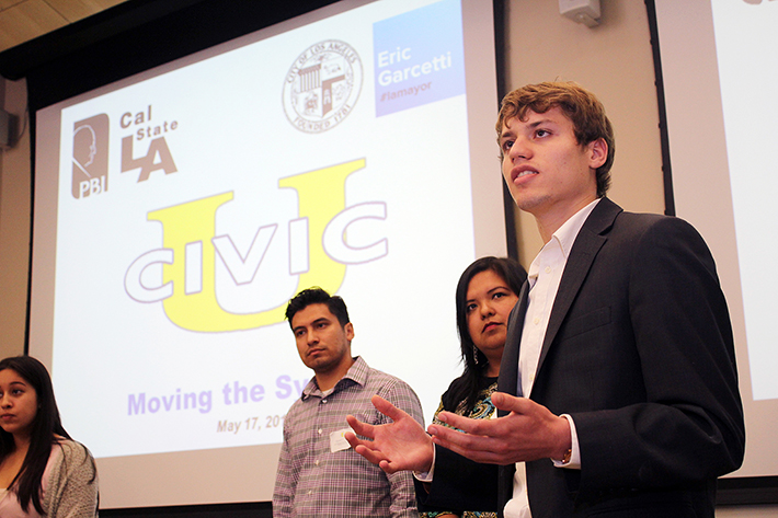 Honors College student Grant Johnson speaks during final pitch presentations at Civic University.