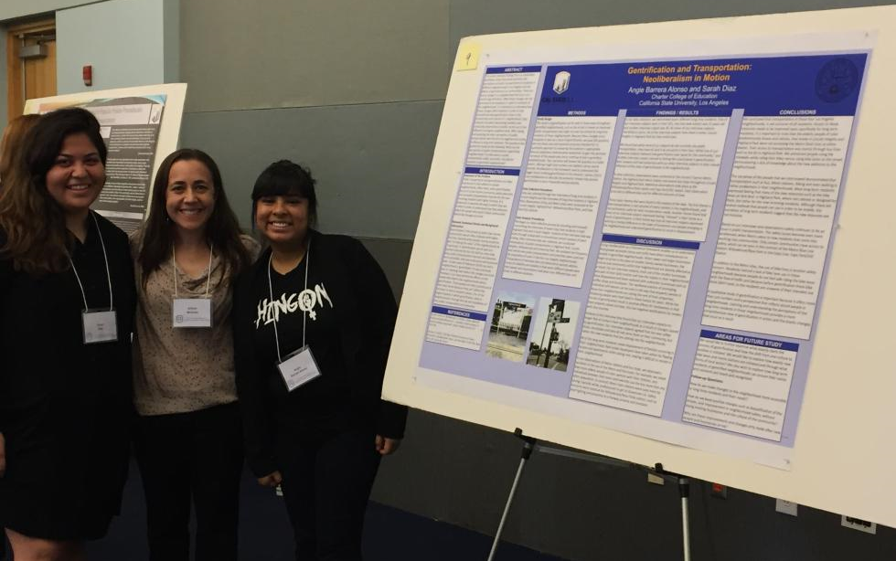 EDFN M.A. students Sarah Diaz and Angie Barrera-Alonso with Dr. Allison Mattheis presenting their award-winning poster