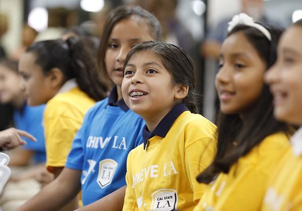 Children in Achieve LA shirts