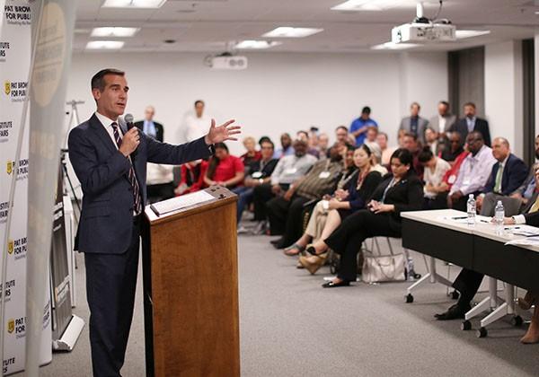 Mayor Garcetti speaking to room of people