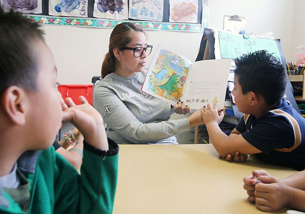 Student reading to children