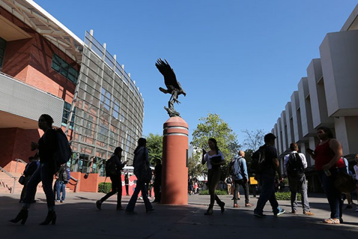 Students walk nearby Golden Eagle statue