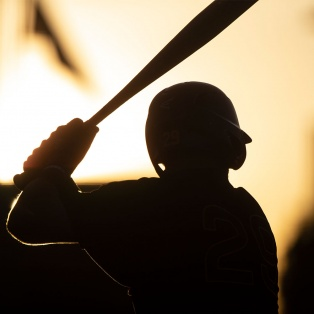 Baseball player with bat and helmet silhouette