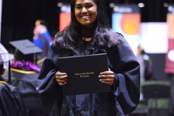 Graduate smiling and holding degree
