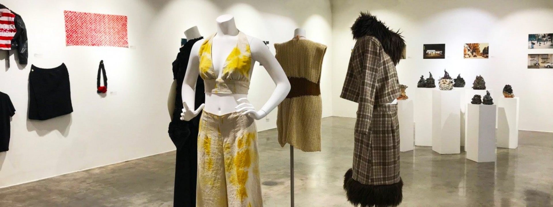 Mannequins in stylish clothing on display in the Ronald H. Silverman Fine Arts Gallery